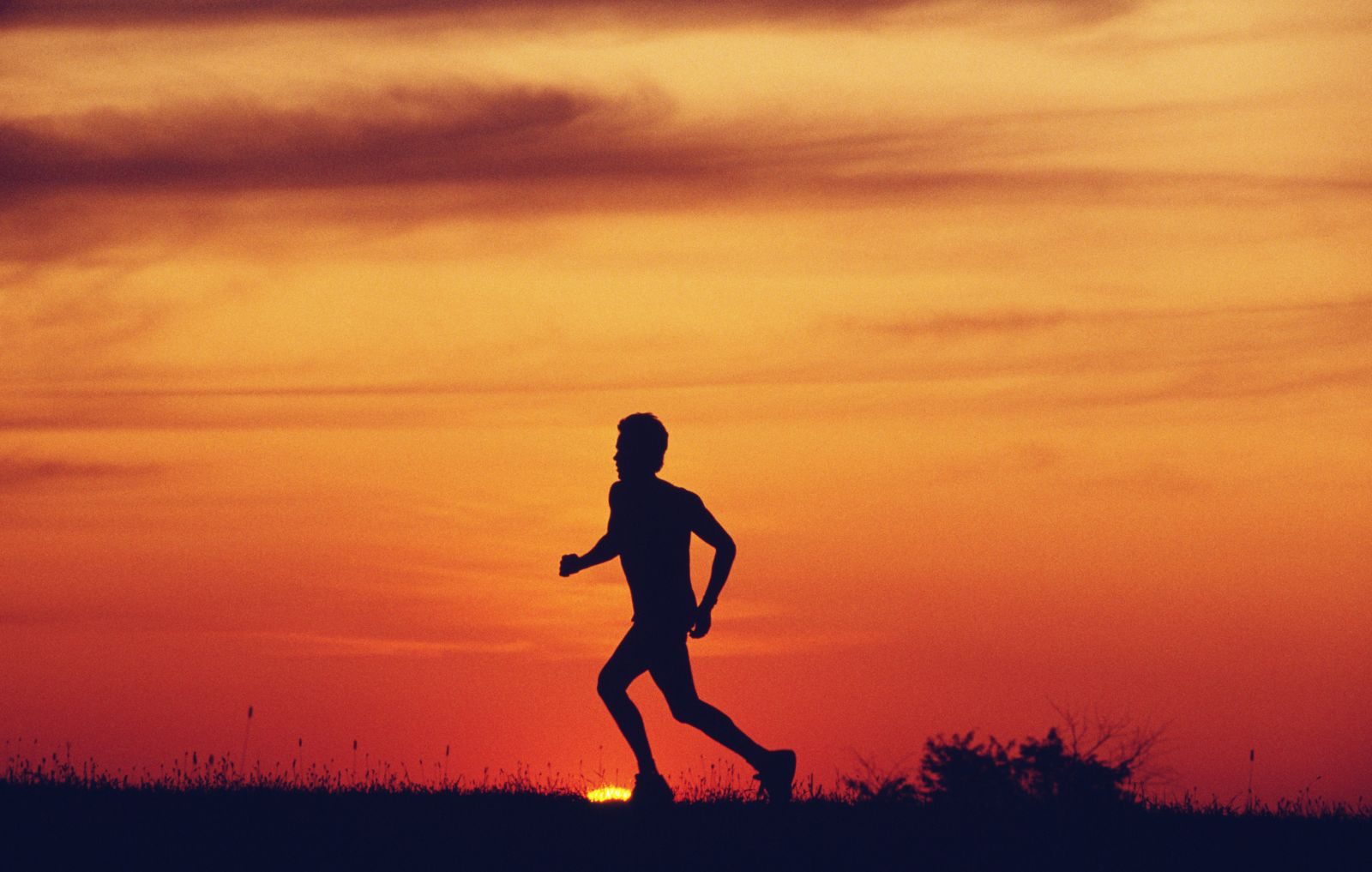 Person running in front of sunset
