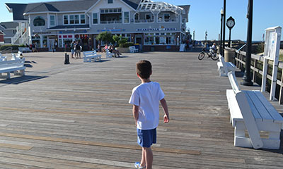 Small boy on boardwalk